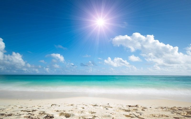 tropical beach with sun reflection
